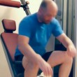 Adult man uses home gym equipment to strengthen his chest muscles. — Stock Video