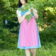 Woman in bavarian traditional dirndl — Stock Photo #32521775
