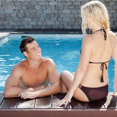Young couple at the pool — Stock Photo