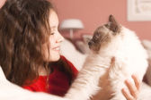 Young girl with her cat — Stock Photo