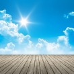 Wooden jetty blue sky sun — Stock Photo #49180539