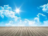 Wooden jetty blue sky sun — Stock Photo