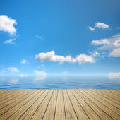Wooden jetty blue sky — Stock Photo