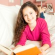 Girl with a book — Stock Photo #49790749