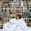 Buried in papers — Stock Photo