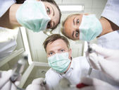 Dentist and nurses — Stockfoto
