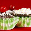 Homemade chocolate cupcakes on red — Stock Photo