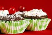 Homemade chocolate cupcakes on red — Stock Photo