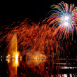 Magrnificient fireworks over a lake - Stock Photo