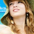 Woman with hat at the beach — Stock Photo