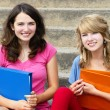 Two girl students at school smiling — Stock Photo