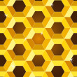 Seamless golden yellow honeycomb pattern — Stock Vector