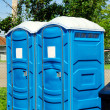 Portable toilets on grass - Stock Photo