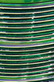 Green and chrome vintage car grill — Stock Photo