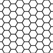 Seamless black honeycomb pattern over white — Stok Vektör