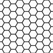 Seamless black honeycomb pattern over white — Stock Vector