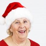 Christmas hat grandma smiling — Stock Photo
