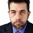 Portrait of unhappy man in suit — Stock Photo