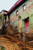Old houses in poor tropical neighborood — Foto de Stock
