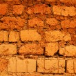 Wall of red earth bricks - Stock Photo