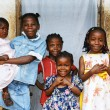African kids all sisters smiling - Stock Photo
