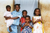 African kids all sisters smiling — Stock Photo