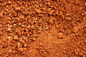 Red earth or soil background — Stock Photo