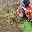 Tractor emoving turf — Stock Photo
