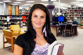 Young woman at library — Stock Photo