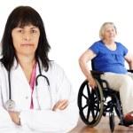 Woman doctor and handicap senior — Stock Photo