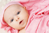 Baby girl in pink scarf — Stock Photo