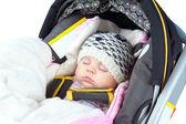 Newborn sleeping in car seat — Stock Photo