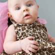Baby girl in leopard print dress — Stock Photo