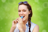 Young woman eating frozen treat — Stock Photo