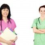 Friendly women doctors or nurses — Stock Photo