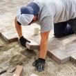 Laying down paver — Stock Photo #27314311