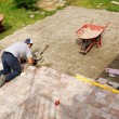 Man laying down paver — Stock Photo #27314371