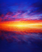 Beautiful sunset over water — Stock Photo