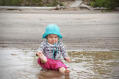 Desaturated baby playing in water — Stock Photo