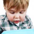 Little boy looking into a box — Stock Photo