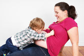 Little boy and pregnant mom belly — Stock Photo