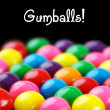 Gumballs on black — Stock Photo