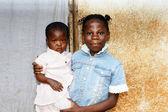 Big sister holding baby — Stock Photo