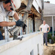 Pouring concrete in styrofoam foundation — Stock Photo #37649929