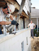 Pouring concrete in styrofoam foundation — Stock Photo