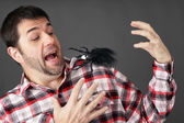 Man scared by fake spider — Stock Photo