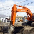 图库照片: Hitachi orange digger and deep hole