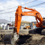 Hitachi orange digger and deep hole — Stock Photo