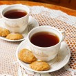 Two tea cups with gold — Stock Photo #38857265