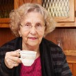 Seinor woman with cup of tea — Stock Photo
